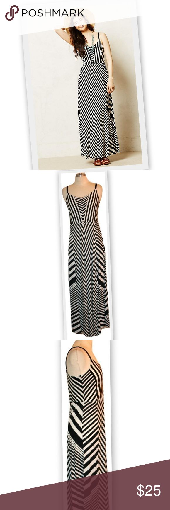 """Anthropologie Lilka Meter Stripe Maxi Dress Anthropologie Lilka """"Meter Stripe"""" dress in black and white.  Weekends call for cozy, throw-on-and-go pieces that can take you from morning lounge sessions to afternoon excursions and even out to dinner, like Lilka's pima cotton dress.  There are 3 tiny holes on the front of the dress, but they are not obvious without close inspection.   Marked size S  Length 51 1/4"""" Anthropologie Dresses Maxi"""