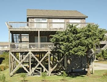 Spend your next getaway at this classic Hatteras-style home just moments from the marina and a short walk to the beach. Eckert Too has everything you need to make your next vacation unforgettable. All four bedrooms are on the first floor. Two queen bedrooms with TVs, one with a private sunroom with futon, share a full Jack-and-Jill bathroom with shower stall and have access to the shaded deck where you can relax in the breeze. A bedroom with two bunk sets shares a full bathroom off the hall…