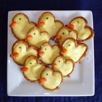 We are going to make these cute candy-pretzel chicks on chocolate bunny making day!
