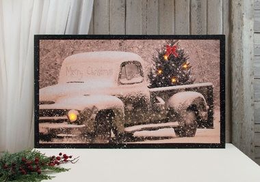 Vintage pick up truck carrying a Christma tree with flickering lights.  Shelley B Home and Holiday has 100s of Lighted Canvas for Christmas and more!
