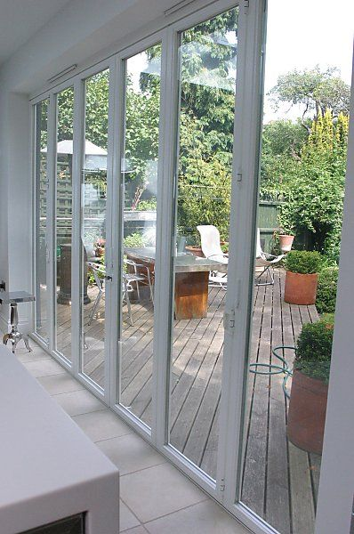 Google Image Result for http://www.heritageconservatories.com/assets/images/kitchen_extensions/kitchen_extension_project_6_concertina_doors_sm.jpg