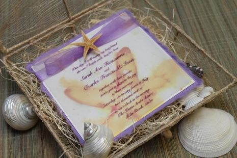 Goergeous 'Seastar Dreams' wedding invitation concealed nicely within an organic sinamay box from Designs By Lenila... Perfect for your beach wedding! Visit designsbylenila.com for more beach wedding invitations