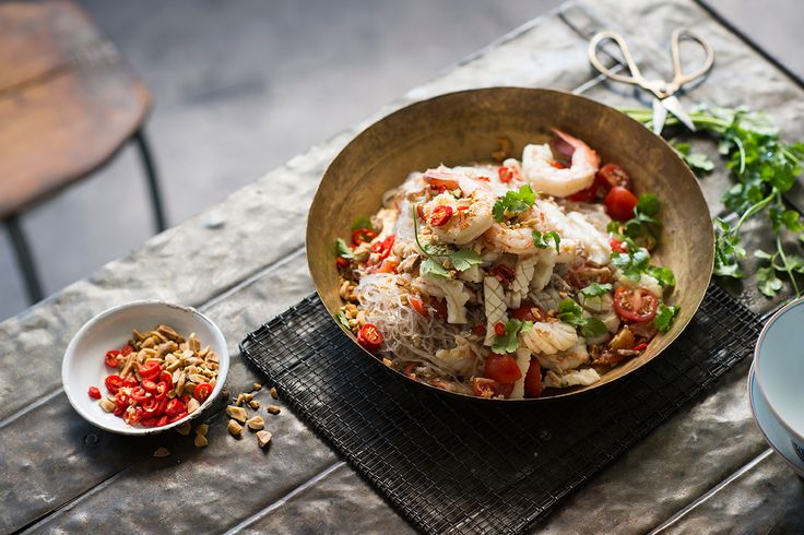 This yum woon sen, which you'll also see cooked on the street too, see the cook stands behind a wok and cook this dish to order. It only takes a few minutes before you are eating this divine plate of seafood noodles.