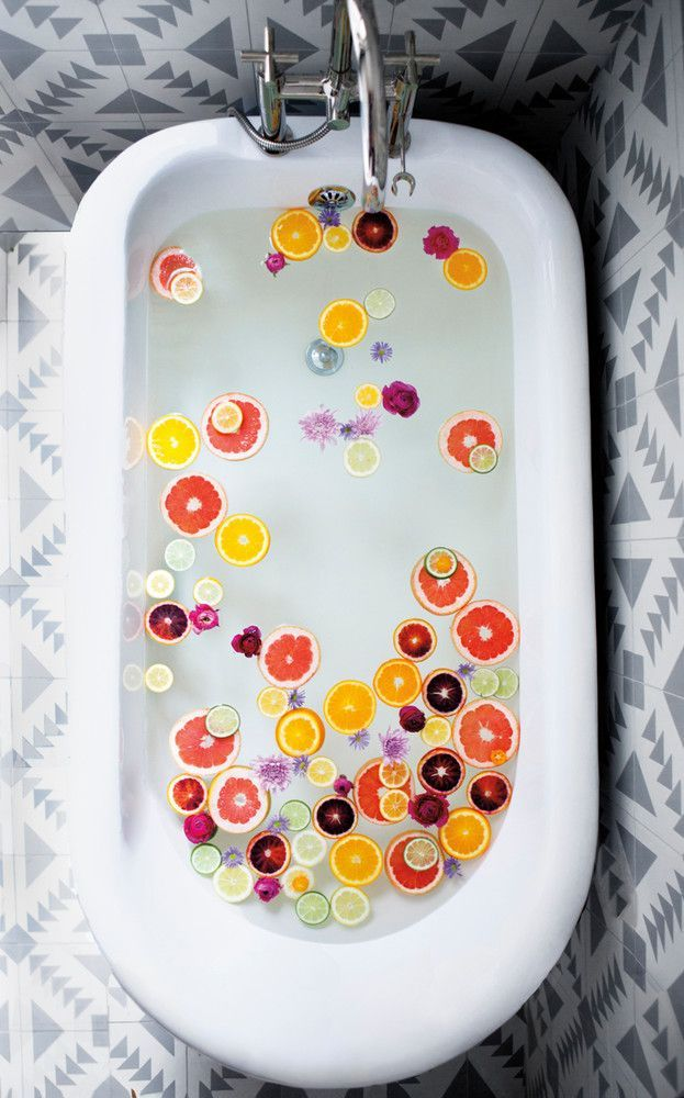 Add sliced citrus to your bath to create a refreshing soak.