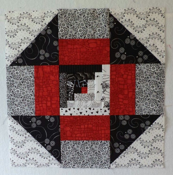 Love the little log cabin block in the middle! Except I would replace the red with lime green!!
