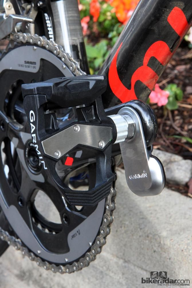 PhotGarmin-Sharp team's Vector pedals with a replaceable stainless steel plate up top