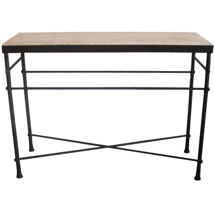 Elegant Modern Craftsman Console / Sofa Table in Hand Hammered Iron in the Manner of Diego Giacometti. The piece has a primitive, yet refined sensibility with its flared sabots, X frame stretcher, parallel cross-bracing and hammered finials Each piece of the frame is hand hammered and the top is composed of Travertine.