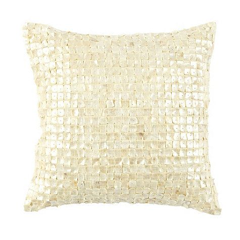 Add glamorous shimmer with a simple toss. Our Fontaine Shell Pillow is a soft blend of neutral cream cotton and iridescent shells. It's hand made by applying curved natural shell tiles over 100% cotton.