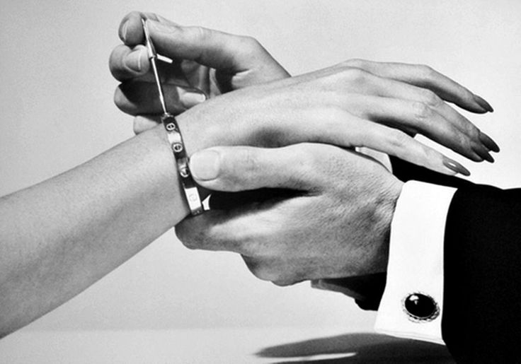 "Cartier Love Bracelet is designed to be opened only using a special screwdriver that is supplied with every bracelet. The screwdriver is also available in the form of a necklace, allowing the bracelet to be ""locked"" onto one person while the ""key"" is kept around the neck of another as a symbol for their commitment to their relationship."