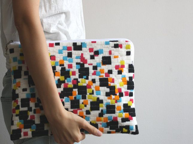 Found via Brit and Co, this is stitched by a japanese designer- not sure who...love the colours and long stitch design