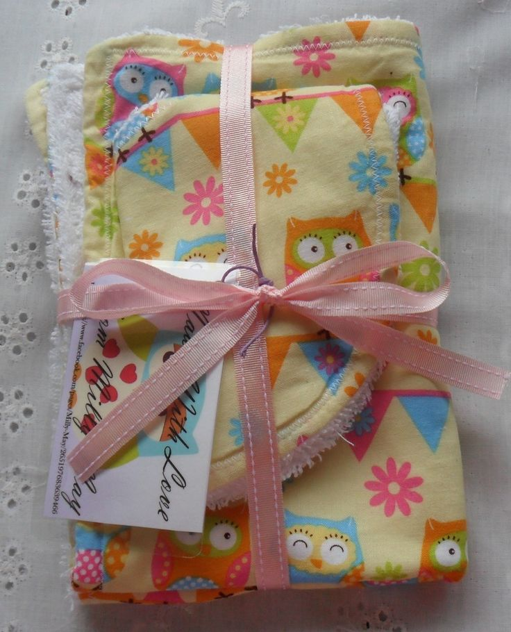 Beautiful Handmade Bib and Burp Cloth sets.Made with lovely cotton front and Toweling backing with Snap closure.Perfect for baby shower or newborn gift.