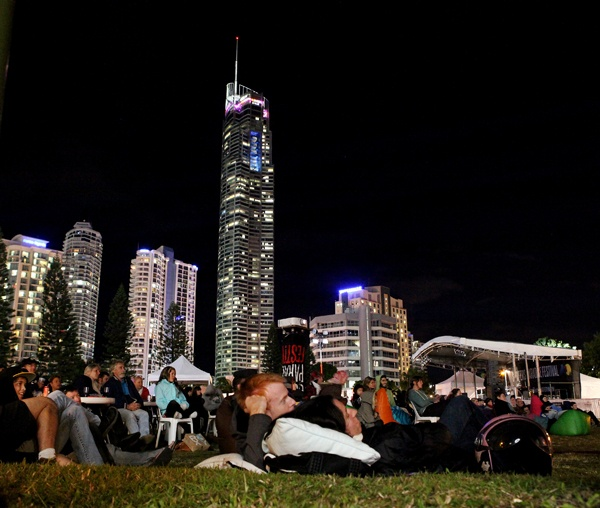 People enjoying the occasional outdoor cinema of Surfers Paradise. We love the skyline in the background, a wonderful example of the luxurious towers in Surfers Paradise
