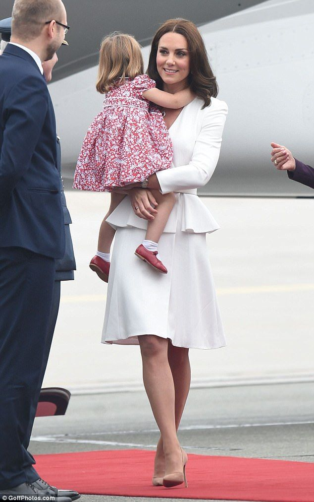 The Duchess of Cambridge made a subtle nod to the Polish flag as she touched down in Warsaw on Monday - with even adorable Princess Charlotte dressed in matching colours