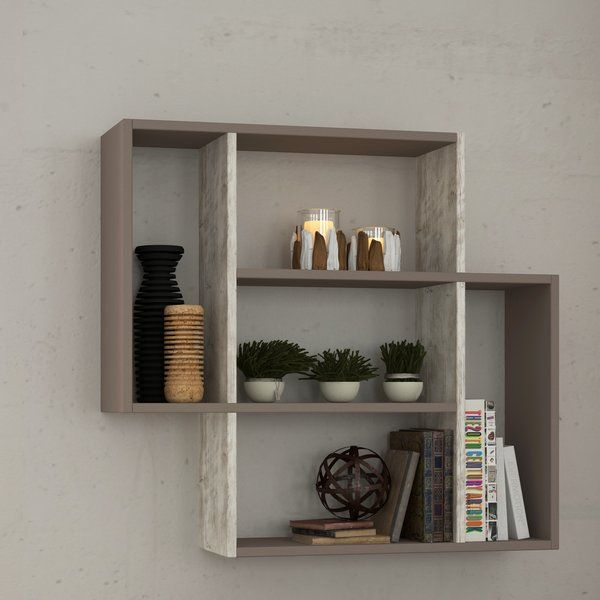 Fill your empty wall space with this unique wall shelf. Featuring shelving for your home and office.