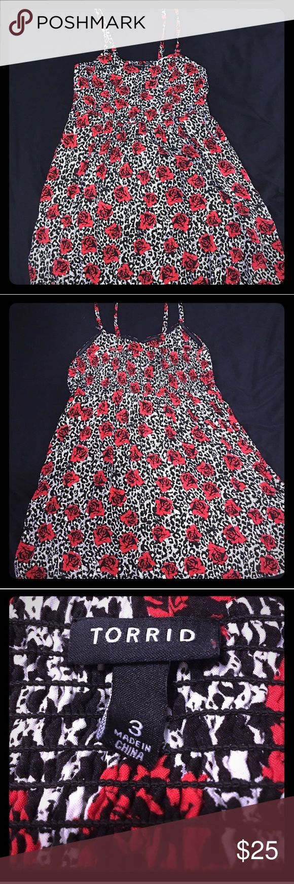 Torrid White Leopard & Red Rose Challis Dress Torrid white leopard with red rose accent challis dress. Removable spaghetti straps for a sexy strapless look! This dress also has pockets! Great for a night out on the town with the girls or a date night with your s.o! Only worn twice! torrid Dresses