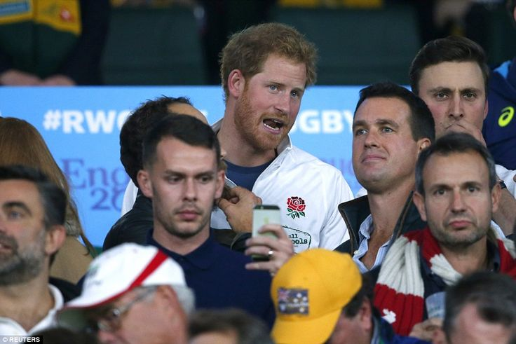 Prince Harry dons an England rugby shirt as he takes in the atmosphere at Twickenham befor...