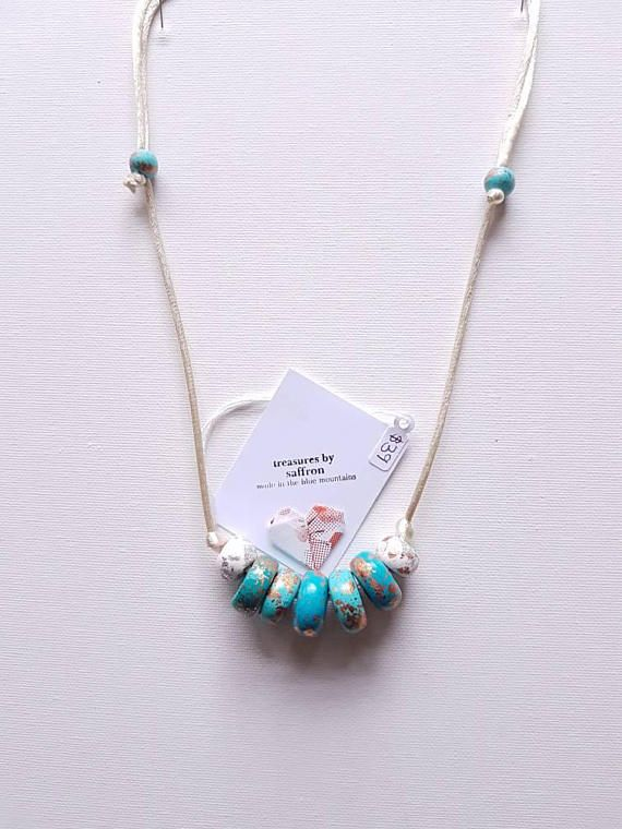 Check out this item in my Etsy shop https://www.etsy.com/au/listing/577345750/handmade-beads-necklace-with-handrolled
