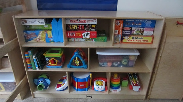 Facilitating the unstructured play by organizing and rotating your toys.