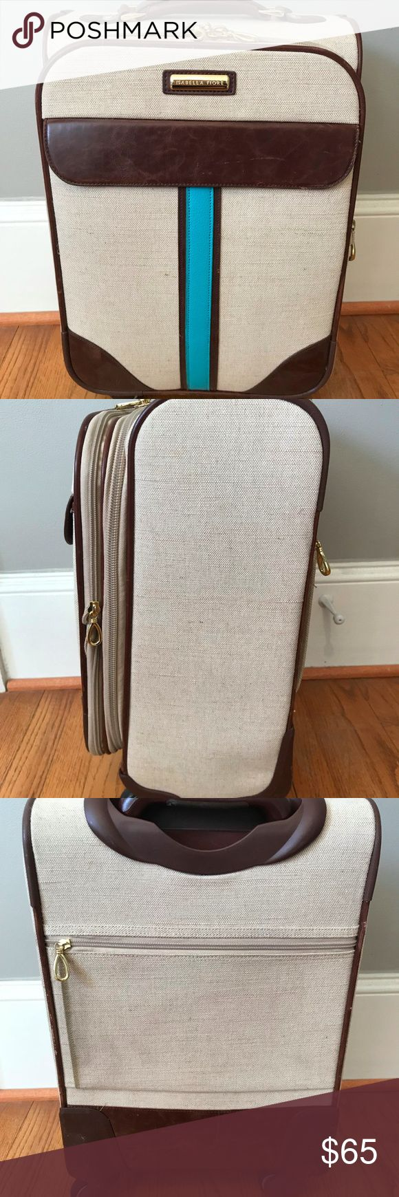 """Isabella Fiore South Hampton 17"""" Carry On Suitcase Isabella Fiore South Hampton 17"""" Carry On Weekend Spinner Suitcase  Shows some signs of wear and use (see photos), but overall in very good condition.  Fits into overhead carry on spaces and can fit underneath the seat on some large airplanes.  Has an expandable zipper to expand approximately 1-2"""".  Multiple interior and exterior pockets and a removable bag for """"extras.""""  360 degree spinner wheels.  Made of linen and faux leather.  Gold tone…"""