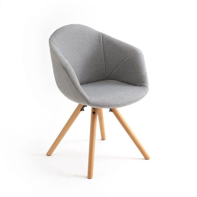 Le fauteuil de table rembourré design ASTING. Un design graphique très stylé et un confort indéniable.Caractéristiques du fauteuil rembourré design ASTING :Revêtement tissu 100 % polyester.Assise polypropylène, garnissage mousse 100 % polyuréthane (24 kg/m³).Piétement hêtre massif, finition vernis nitrocellulosique.Retrouvez d'autres modèles de la collection Asting sur laredoute.fr.Dimensions du fauteuil de table rembourré design Asting :- Totales :Longueur : 58 cmHauteur : 81 cmProfond...