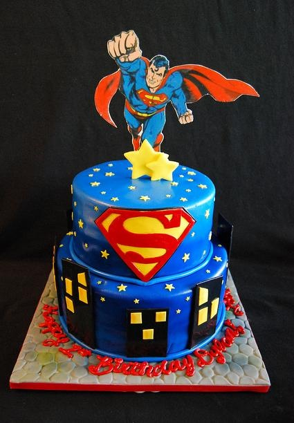 2-tier superman cake love the colors but the topper is cheesy