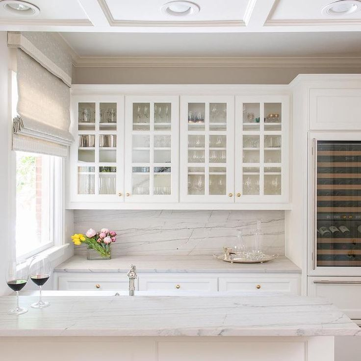 Stunning Kitchen Features Glass Front Upper Cabinets And White Inset Lower Cabinets Adorned With