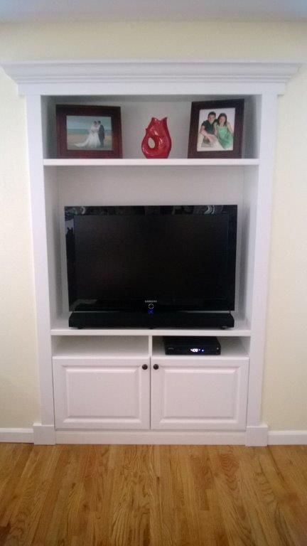 Fill in that recessed space in the house with a custom for In wall tv cabinet