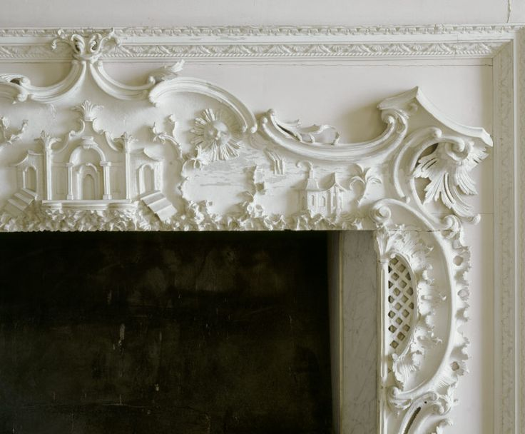 Detail of the frieze above the fireplace in The Paper Room at Claydon House, Buckinghamshire