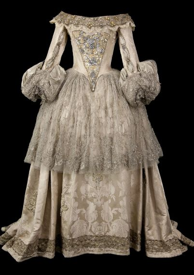 17th-Century Style Gown : Pink-beige brocade embroidered with sequins and silver beads on the bodice, with silver embroidered tulle on the sleeves and skirt.