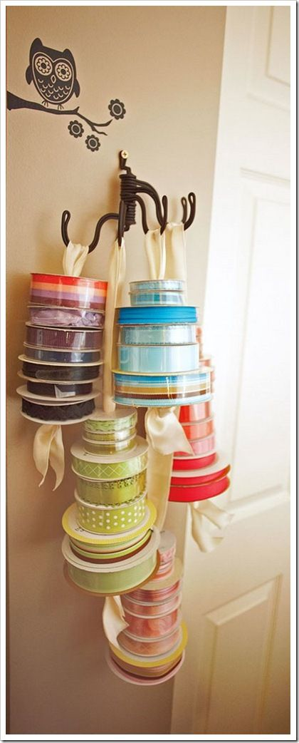 Don't hide your beautiful ribbon in a box! Here's a creative way to hang rolls of ribbon…a towel holder!