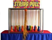 String Pull Carnival Game - This is a classic carnival midway arcade game in which the player has to select three strings from among a strand of lots of strings. and see if theypull up objects of the same color.  Its harder than it looks!  The String Pull Carnival Game rental can be rented from San Diego Kids Party Rentals.