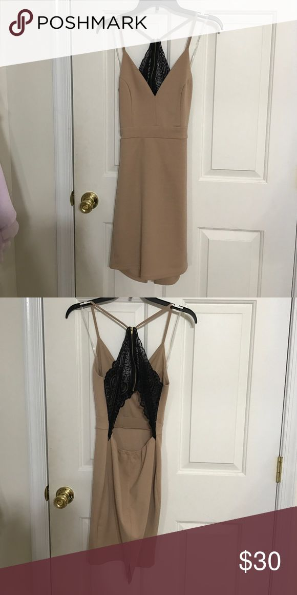 Nude dress with black lace cut out Nude mini dress with lacy black cut out detail Charlotte Russe Dresses