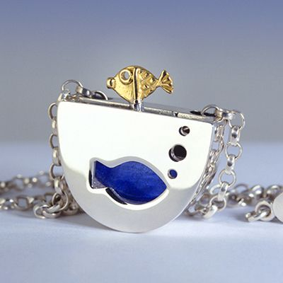 Jumpin' Fish Pendant from http://www.alanardiff.com.  As the chain runs through the pendant, the fish jumps out of the bowl