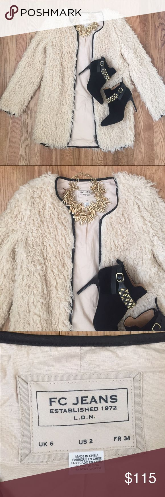 French Connection faux-fur fashion jacket French Connection faux-fur fashion jacket.  Cream color with black trim around the zipper.  Size 2 but runs small.  Fits more like a 0.   Excellent condition.  Only worn twice. French Connection Jackets & Coats