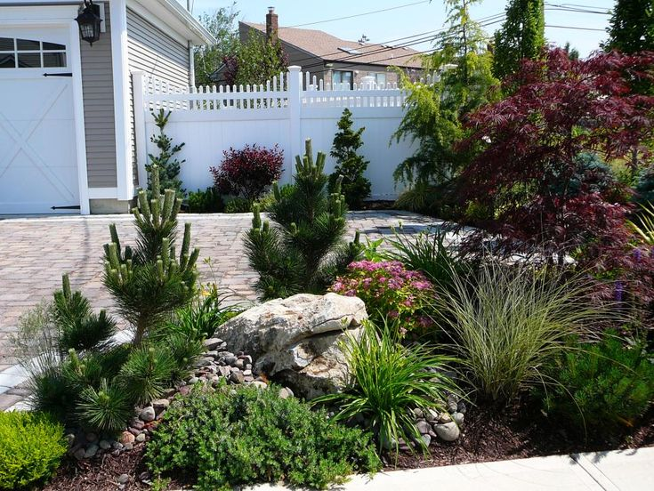 A landscaped bed with ornamental grass evergreens and a for Garden design visualiser