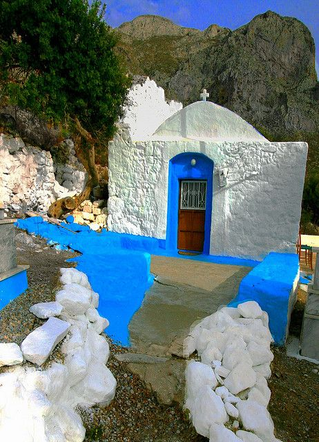 Small country church against cliffs. Skalia, Kalymnos island, Greece