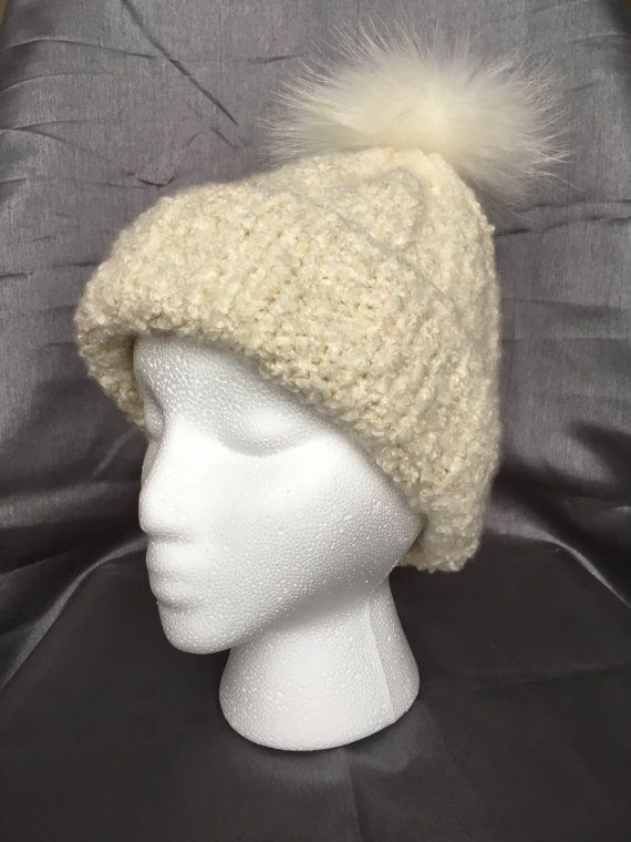 Material: 93% Cashmere, 7% Silk Color: Ivory 100% Hand Knit Boucle Yarn This beautiful cream color hat will be great for autumn and winter. It is very soft. It was made with 100% natural materials. decorated with pom pom  Hand wash in cold water with detergent or shampoo and lay flat