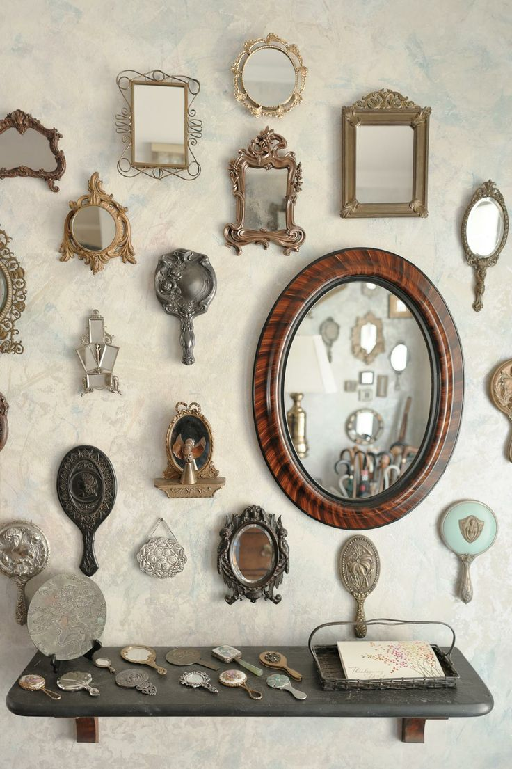 hanging antique hand mirrors