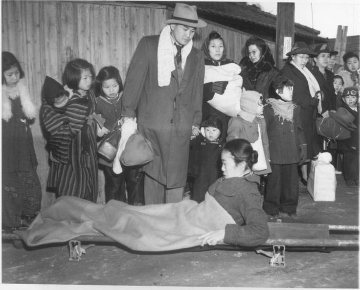"""""""Sick Repatriate Reaches Japan -- A sickly Japanese woman repatriated from the United States rises on her elbows on her stretcher after being carried from the liner Matsonia at Uraga, Japan, Christmas Day. Two hundred eighty-five families returned to Japan on the vessel. For their first meal in Japan, a Christmas dinner, the repatriates were given rice, boiled celery and a slice of apricot."""" -- caption on photograph."""