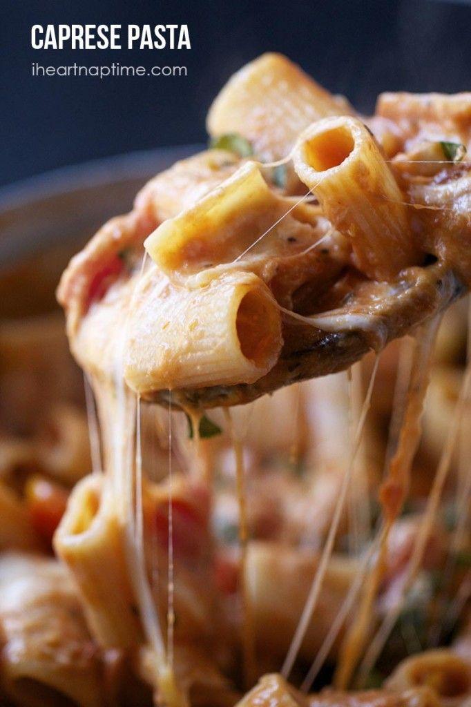 Caprese Pasta     1 lb rigatoni pasta     1 tsp kosher salt     1 TB olive oil     2 cups prego spaghetti sauce     1/2 cup grated parmesan cheese     1/2 cup heavy cream     2 ounces mozzarella     1 cup grape tomatoes     3-5 fresh basil leaves