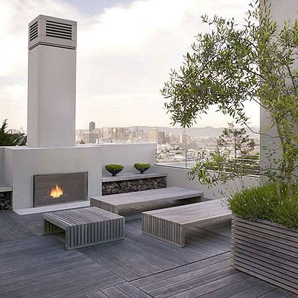 Yes, that's a city scape in the background! Ugh, how fun to have a fireplace on a lovely roof deck like this.   #roofdeck #rooftopgardens #urbangardens