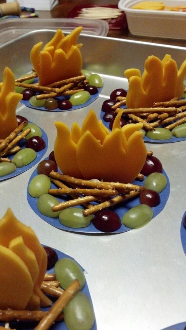 Here's an idea for a super cute campfire snack made of cheese, pretzels, and grapes.