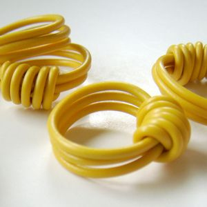 Grain's Electric Love, Hand-knotted rings of reclaimed electrical wire.