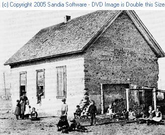 The first school house in Colorado Springs about 1870.