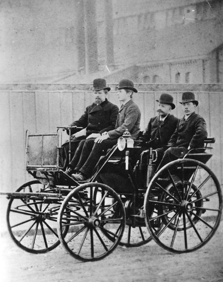 German car manufacturers Wilhelm Maybach and Paul Daimler in the first four-wheeled Daimler car. (Photo by Hulton Archive/Getty Images - 1895)