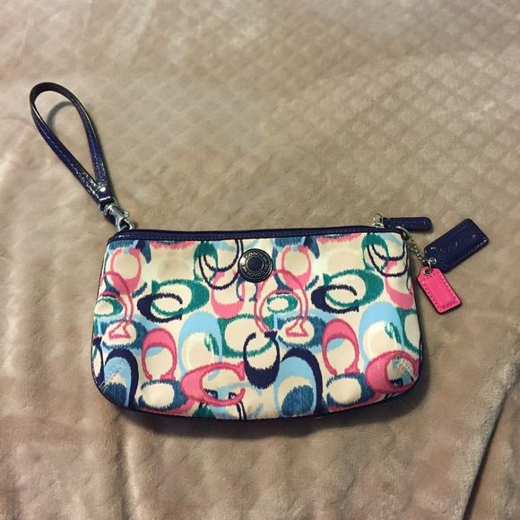 SALE Authentic Large Coach Wristlet Like new, card slots and slip pocket inside. Full zip. Gorgeous colors and matching bag to follow in my closet! Very minimal wear Coach Bags Clutches & Wristlets