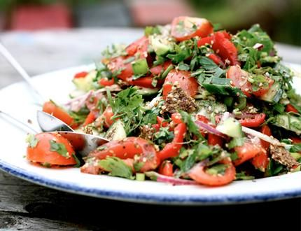 FATTOUSH SALAD 2 medium cucumbers, with skin  3 cups chopped tomatoes (I used a combination of cherry, plum, and grape tomatoes)  2 red bell peppers  1 large red onion  3 green onions  1 cup chopped flat-leaf parsley  ¾ cup chopped mint  raw flax crackers, flatbread, or toasted pita