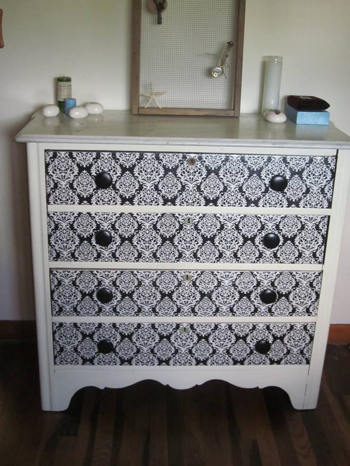 Chest of drawers made new with a little bit of damask wrapping paper and decoupage, wooden draw handles painted black and varnished.......cost only $3.00