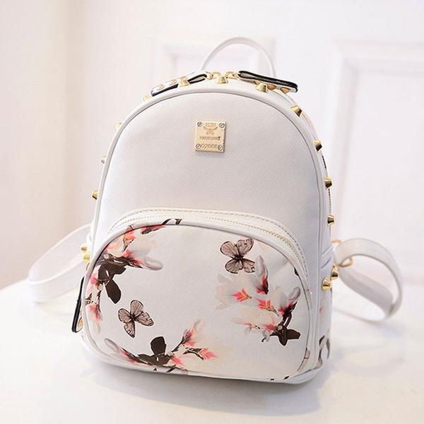Carry all your belongings around in Style with the Cute Studded Mini Backpack - DURABLE--Made with High Quality Water and Tear Resistant PU Leather. Interior Polyester Lining. Metal Zipper Closure - L