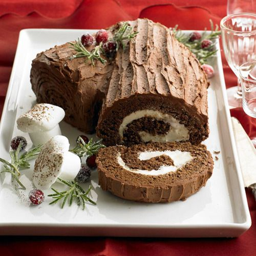 Mocha Buche de Noel ~ Bring back a Christmas classic - this log features rolled chocolate cake and cream cheese frosting, as well as decorative sugared cranberries.